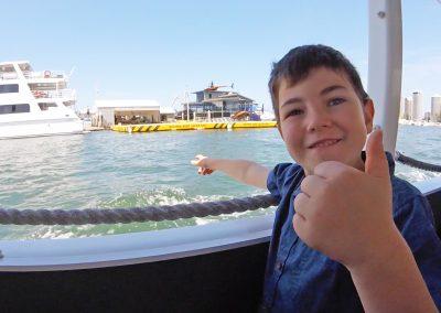Happy Boy on Duck bus