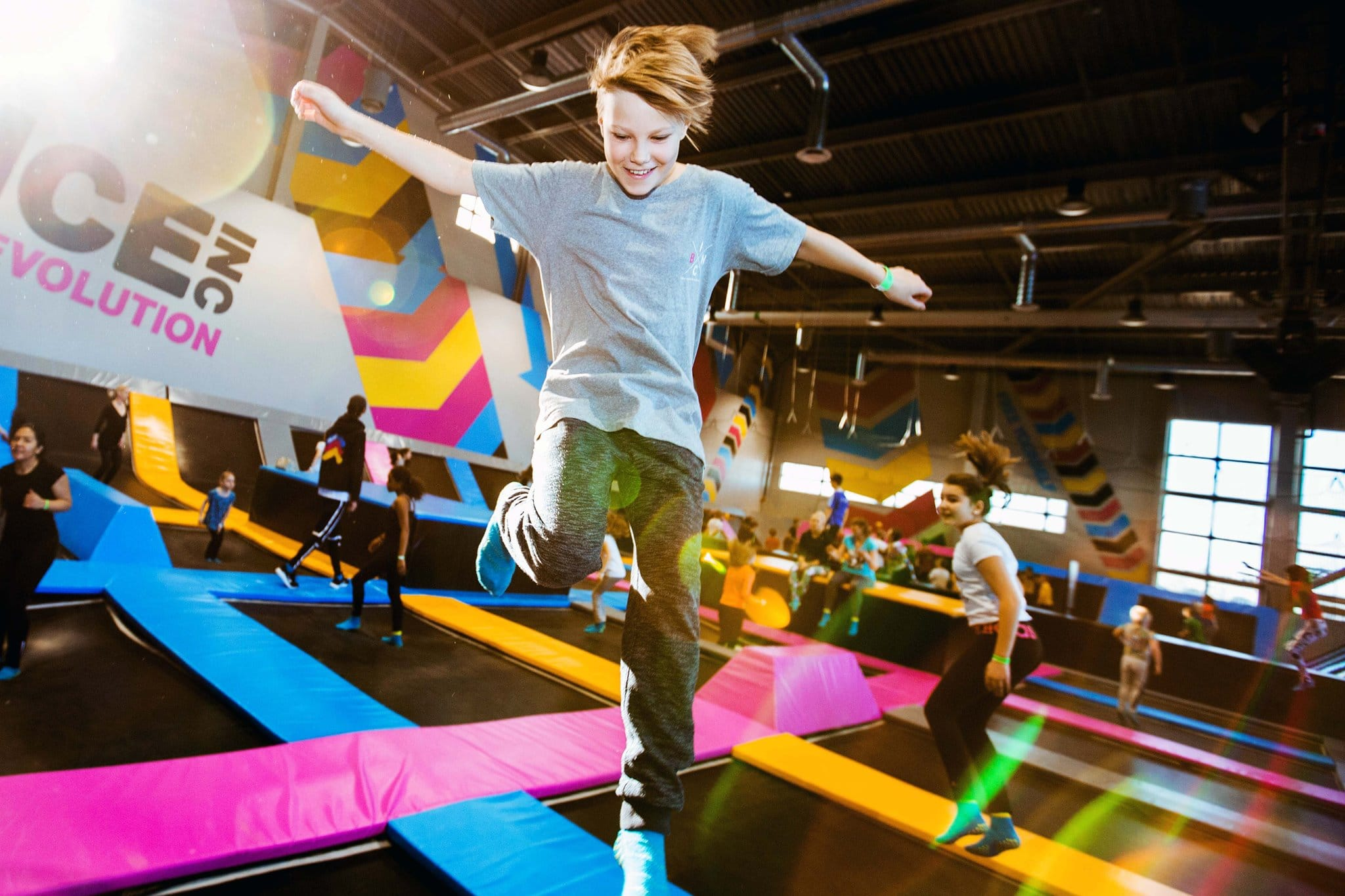kids bouncing on trampolines